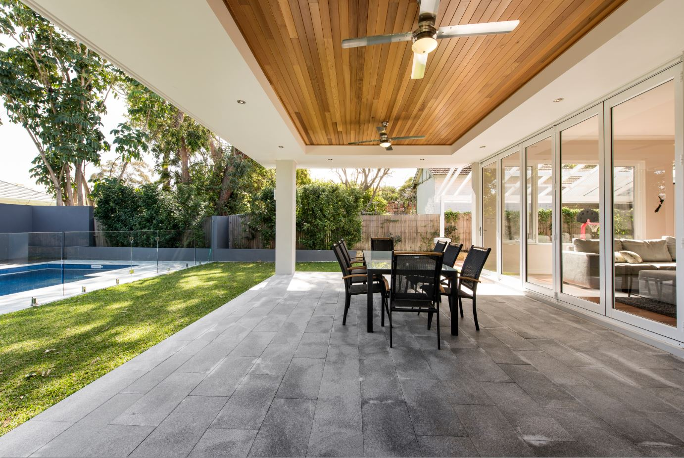 The coffered ceiling in this alfresco area is lined with cedar, and it is a feature that raises the quality of the home. Downlights surrounding can be dimmed, making it a beautiful space in the evenings.