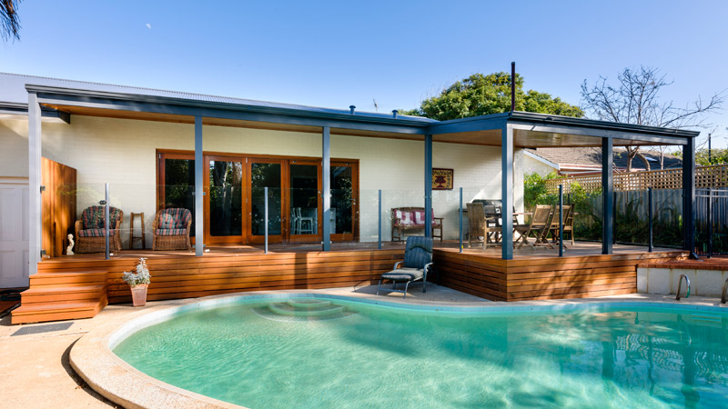 With not a lot of space to extend the home to the pool area, a great solution was an expansive deck. This home extension provided the right space for parents to sit and overlook the pool.