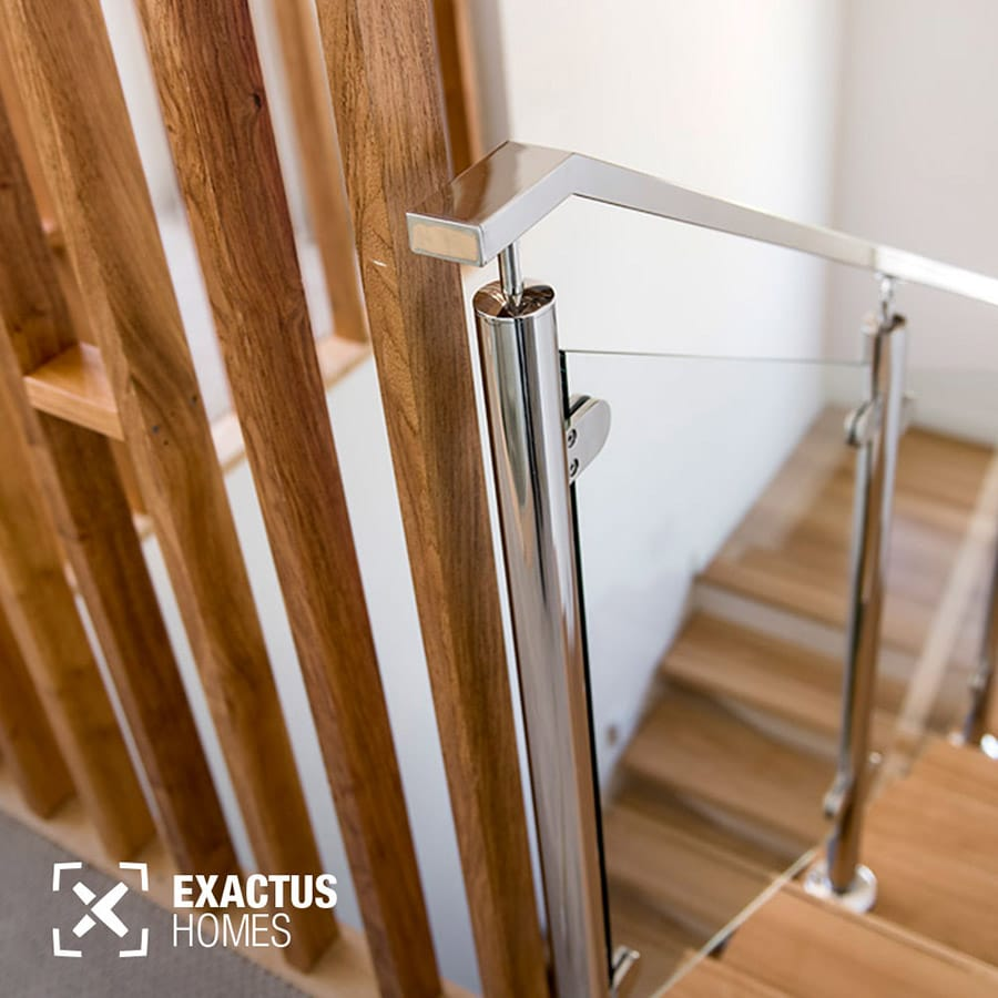 Giving great attention to detail is something the team at Exactus Homes strives to do in every aspect of construction, evident in this timber staircase with glass balustrade and a feature timber screen.