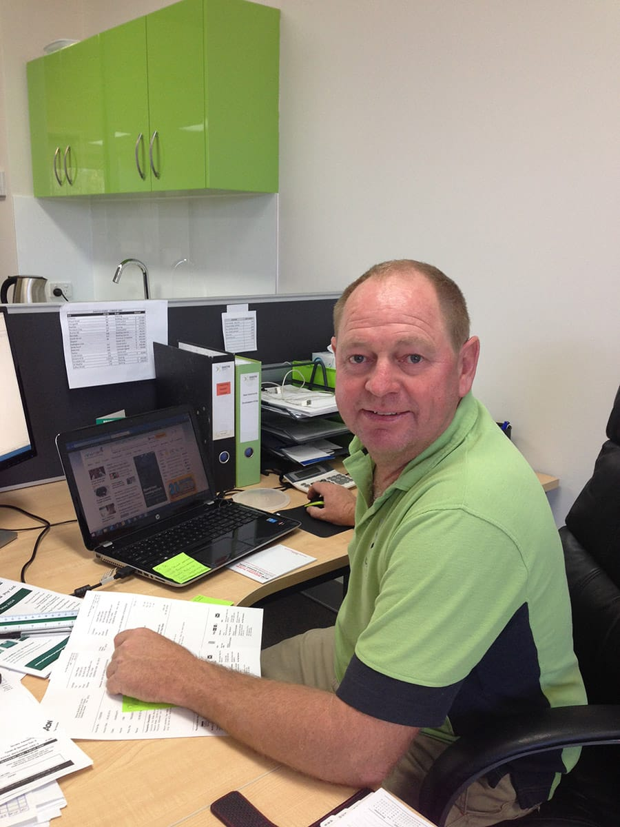 Our Owner, Ralph Brewer, hard at work at his desk planning an upcoming home extension (or possibly paying invoices!)