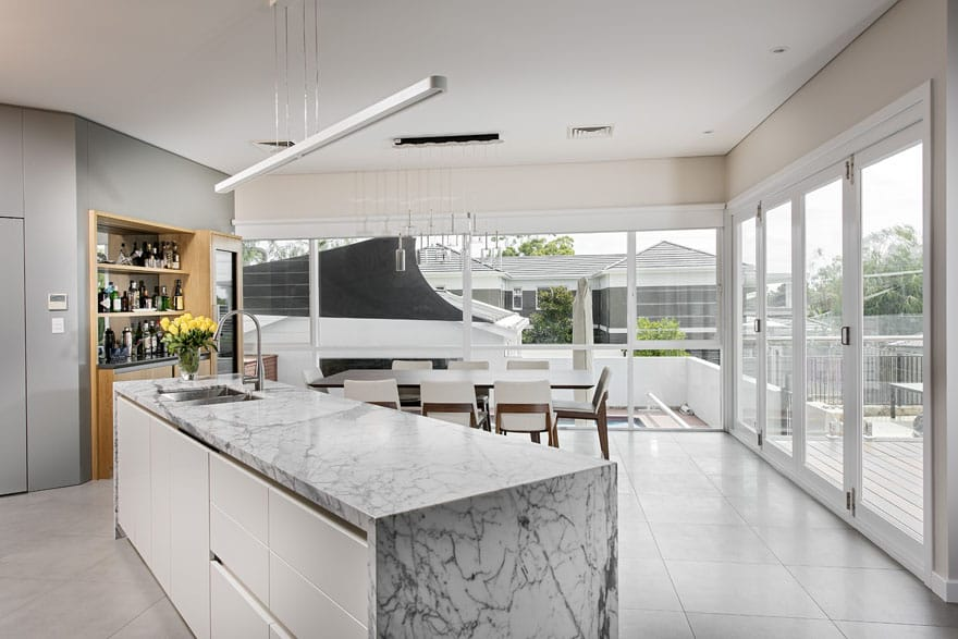 A beautiful kitchen integrated with a living area makes for a very happy family life!