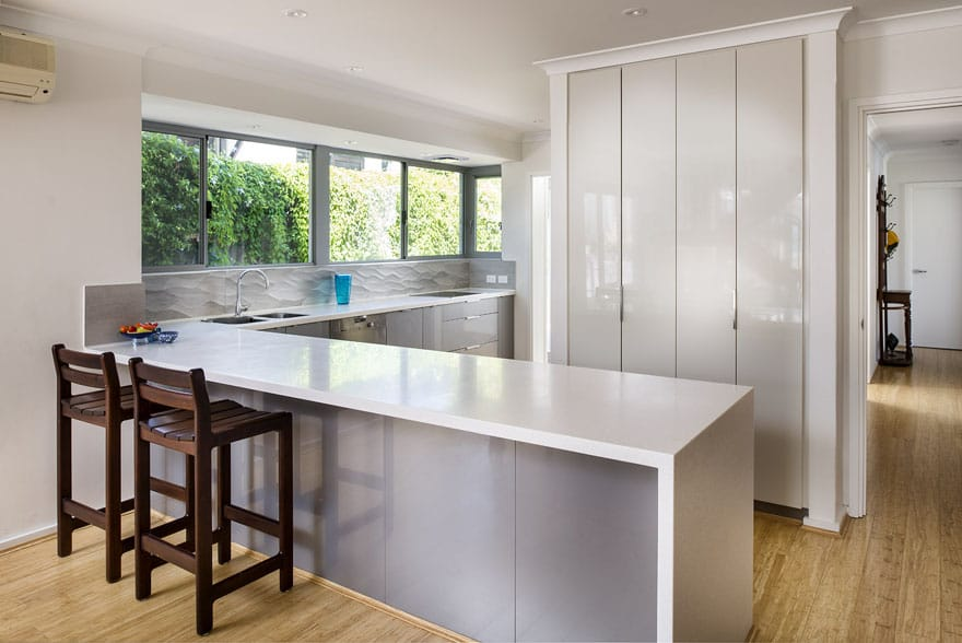 The choice of materials in a grey colour palette, and the selection of different textures produced a great final outcome for this modern kitchen renovation in City Beach.